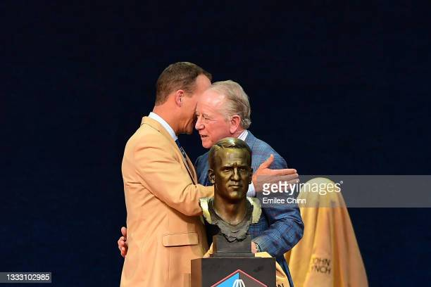 Peyton Manning shares a moment with his father Archie Manning after unveiling his bust during the NFL Hall of Fame Enshrinement Ceremony at Tom...