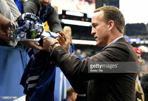 Peyton Manning signs autographs before the game against the Tennessee Titans and Indianapolis Colts at Lucas Oil Stadium on November 18 2018 in...