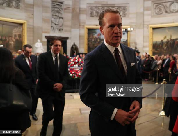 Peyton Manning walks away after paying his respects in front of the casket of the late former President George HW Bush as he lies in state in the US...