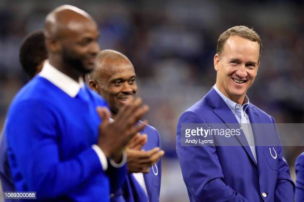 Peyton Manning watches his former teammate Reggie Wayne at his induction to the Colts Ring of Honor at Lucas Oil Stadium on November 18 2018 in...
