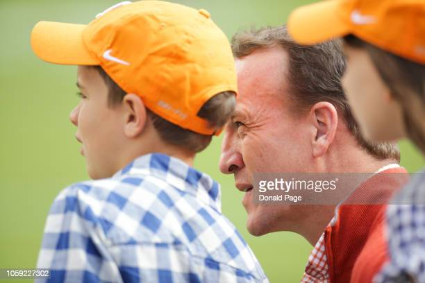 Peyton Manning with his son Marshall Manning before the game between the Alabama Crimson Tide and the Tennessee Volunteers at Neyland Stadium on...