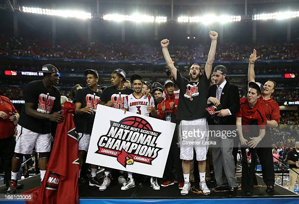 Peyton Siva and Luke Hancock of the Louisville Cardinals celebrate with their teammates after they won 8276 against the Michigan Wolverines during...
