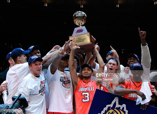 Peyton Siva and the Louisville Cardinals celebrate after defeating the Cincinnati Bearcats during the finals of the Big East Men's Basketball...
