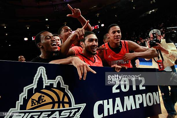 Peyton Siva, Angel Nunez and the Louisville Cardinals celebrate after defeating the Cincinnati Bearcats during the finals of the Big East Men's...