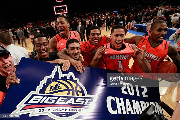 Peyton Siva Angel Nunez Chris Smith and the Louisville Cardinals celebrate after defeating the Cincinnati Bearcats during the finals of the Big East...