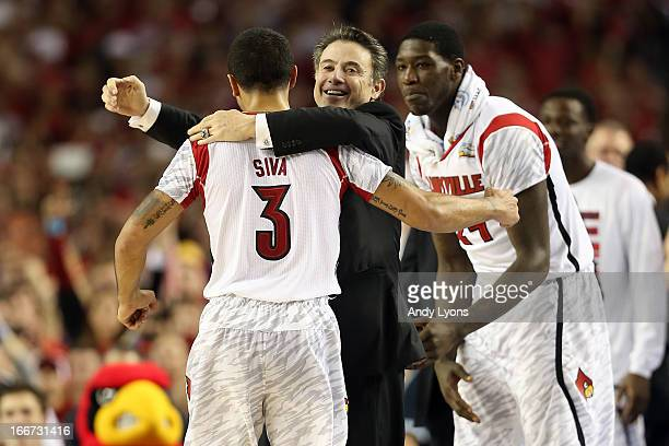 Peyton Siva head coach Rick Pitino and Montrezl Harrell of the Louisville Cardinals celebrate against the Michigan Wolverines during the 2013 NCAA...
