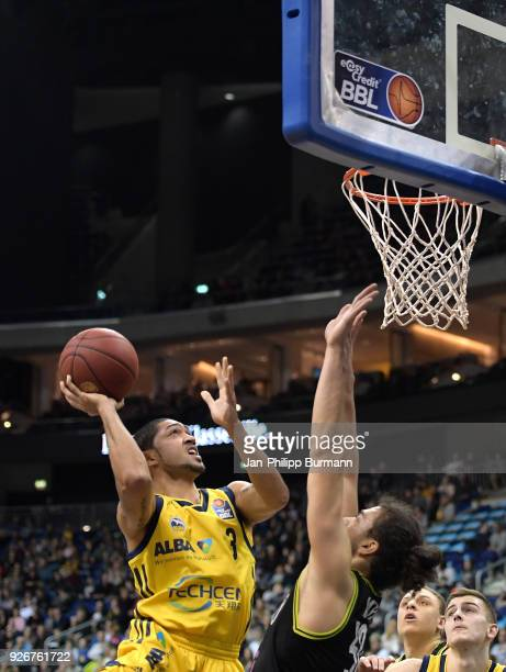 Peyton Siva of Alba Berlin and Assem Marei of medi Bayreuth during the easyCredit BBL game between Alba Berlin and medi Bayreuth at MercedesBenz...