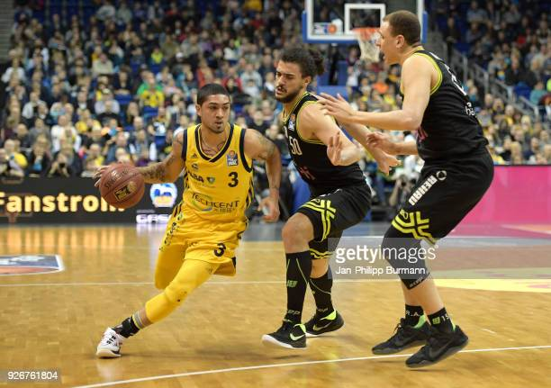 Peyton Siva of Alba Berlin Assem Marei and Robin Amaize of medi Bayreuth during the easyCredit BBL game between Alba Berlin and medi Bayreuth at...