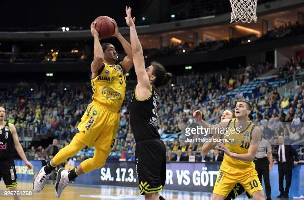 Peyton Siva of Alba Berlin Assem Marei of medi Bayreuth and Tim Schneider of Alba Berlin during the easyCredit BBL game between Alba Berlin and medi...