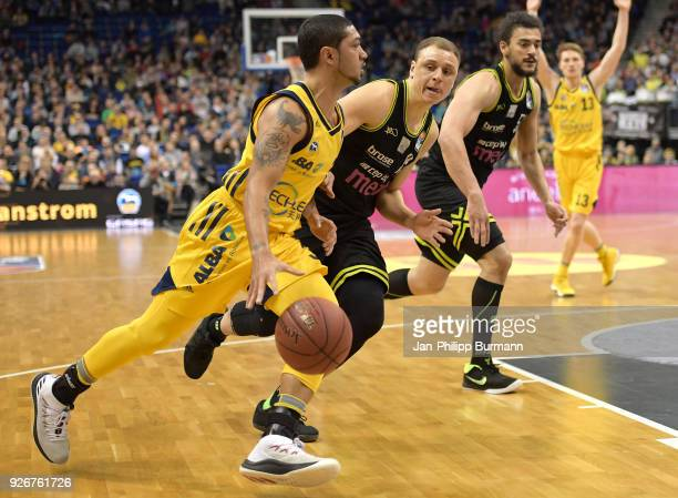 Peyton Siva of Alba Berlin Robin Amaize and Assem Marei of medi Bayreuth during the easyCredit BBL game between Alba Berlin and medi Bayreuth at...