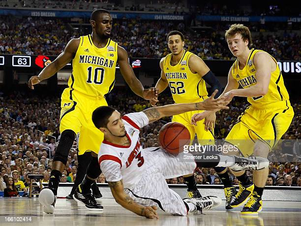Peyton Siva of the Louisville Cardinals attempts to control the ball in the second half as he falls down against Tim Hardaway Jr #10 Jordan Morgan...