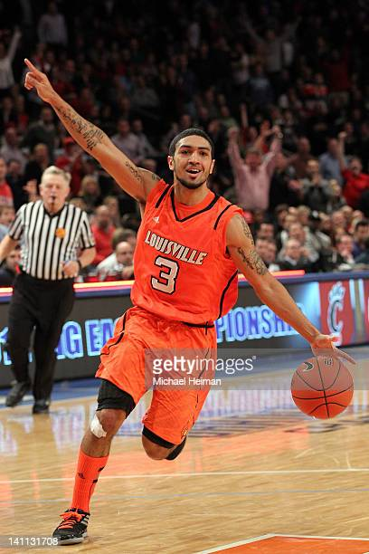 Peyton Siva of the Louisville Cardinals celebrate after defeating the Cincinnati Bearcats during the finals of the Big East Men's Basketball...
