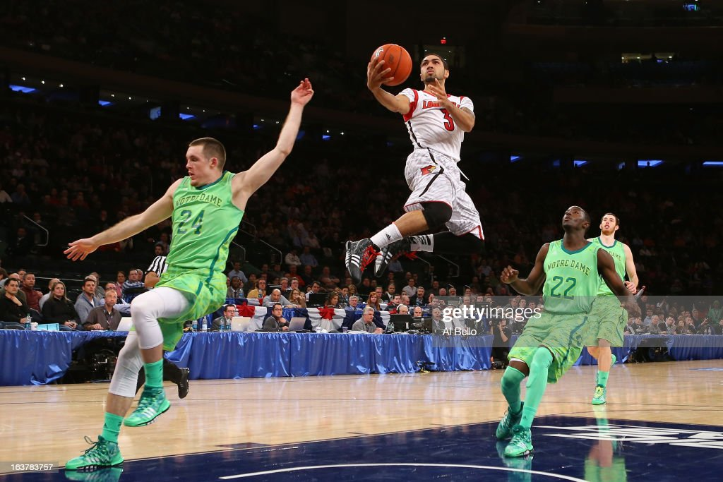 Peyton Siva #3 of the Louisville Cardinals drives for a shot attempt against Pat Connaughton #24 and Jerian Grant #22 of the Notre Dame Fighting Irish during the semifinals of the Big East Men's Basketball Tournament at Madison Square Garden on March 15, 2013 in New York City.