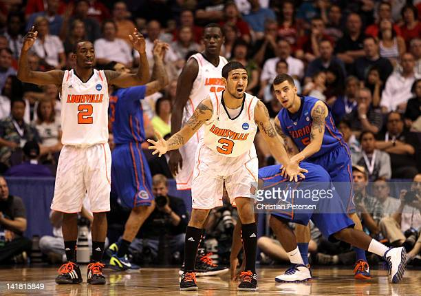 Peyton Siva of the Louisville Cardinals reacts after being called for a foul in the second half while taking on the Florida Gators during the 2012...