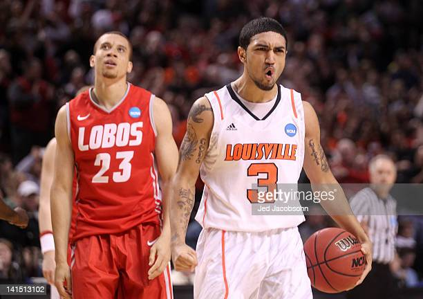 Peyton Siva of the Louisville Cardinals reacts in the second half as he stands in front of Phillip McDonald of the New Mexico Lobos during the third...