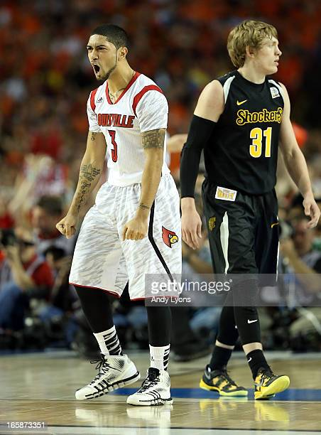 Peyton Siva of the Louisville Cardinals reacts in the second half against Ron Baker of the Wichita State Shockers during the 2013 NCAA Men's Final...