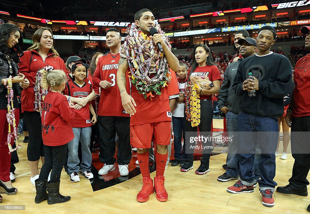 Peyton Siva #3 of the Louisville Cardinals talks to the crowd following the game against the Notre Dame Fighting Irish at KFC YUM! Center on March 9, 2013 in Louisville, Kentucky.