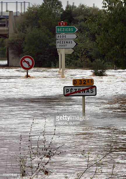 Picture of signboards in a flooded road following heavy rain over the region taken 20 October 2006 in Pezenas southwestern France AFP PHOTO PASCAL...