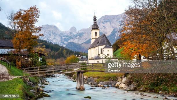 pfarrkirche st. sebastian during autumn in ramsau, berchtesgaden, germany - berchtesgaden national park stock photos and pictures