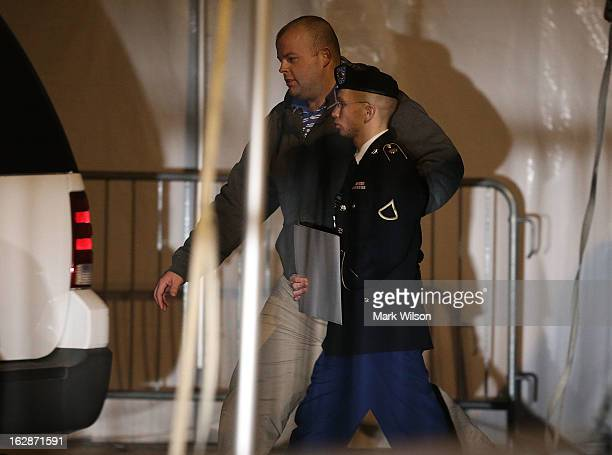 Pfc. Bradley E. Manning is escorted from a hearing, on February 28, 2013 in Fort Meade, Maryland. Manning attended a motion hearing in the case of...