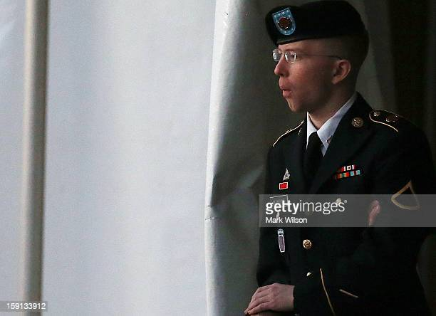 Pfc Bradley E Manning is escorted from a hearing on January 8 2013 in Fort Meade Maryland Manning attended a motion hearing in the case of United...