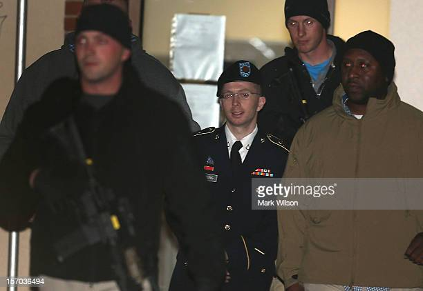 Pfc. Bradley E. Manning is escorted from a hearing, on November 27, 2012 in Fort Meade, Maryland. Manning attended a motion hearing in the case of...