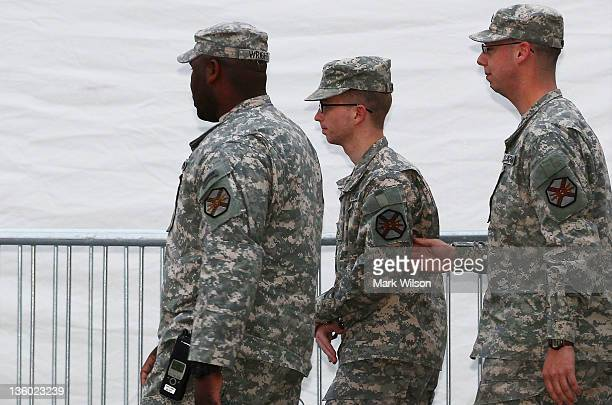 Pfc Bradley Manning is escorted from his his Article 32 hearing December 16 2011 in Fort Meade Maryland Manning is accused of disclosing more than...
