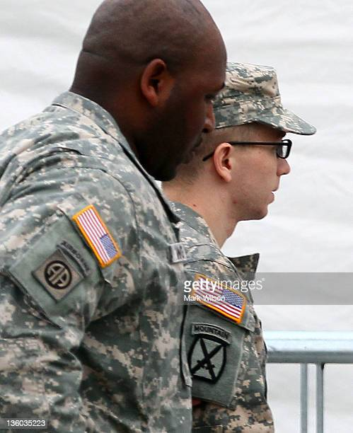 Pfc. Bradley Manning , is escorted into a building to attend the second day of his Article 32 hearing, on December 17, 2011 in Fort Meade, Maryland....