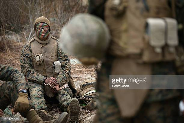 Pfc Cristiana Alvarez of Milwaukee Wisconsin takes a break during her patrolling techniques class at Marine Combat Training on February 22 2013 at...