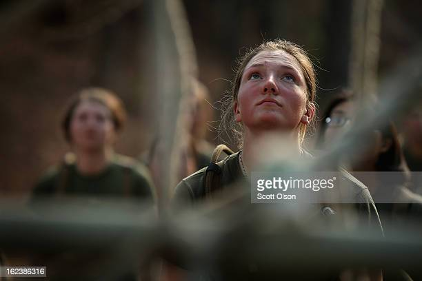 Pfc Hannah Schuller prepares to climb an obstacle on the Endurance Course during Marine Combat Training on February 20 2013 at Camp Lejeune North...