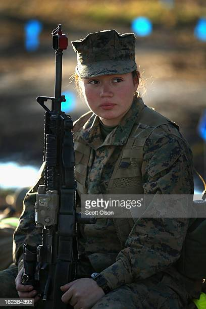 Pfc Laura Mercadobecerra prepares to head out with other male and female Marines on a 15 kilometer night hike carrying a 55 pound pack during Marine...