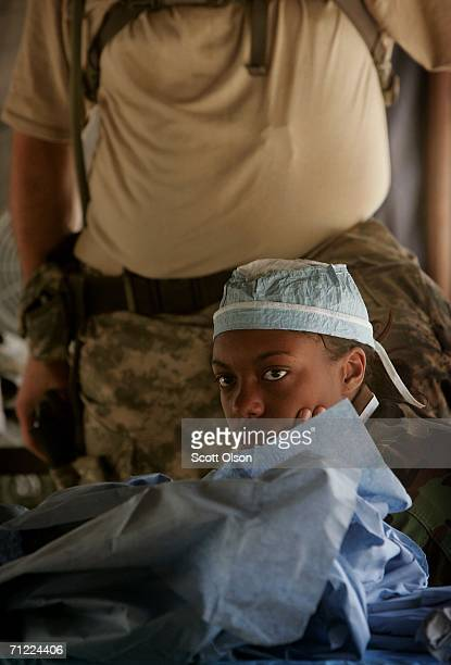 Pfc Lisa Williams of Pensacola Florida listens to a critique of her performance after working on a simulated casualty during training with the 946th...