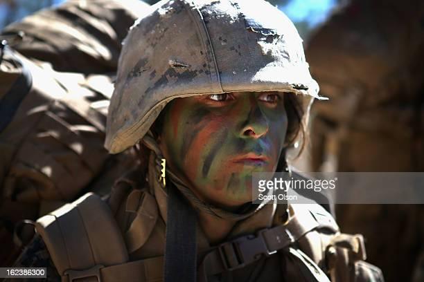 Pfc Margarita Salinas patrols during Marine Combat Training on February 20 2013 at Camp Lejeune North Carolina Since 1988 all noninfantry enlisted...