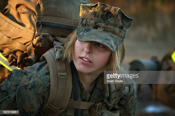 Pfc Schevlle Woodard from Grand Prairie Texas prepares to head out on a 15kilometer night march with male and female Marines during Marine Combat...