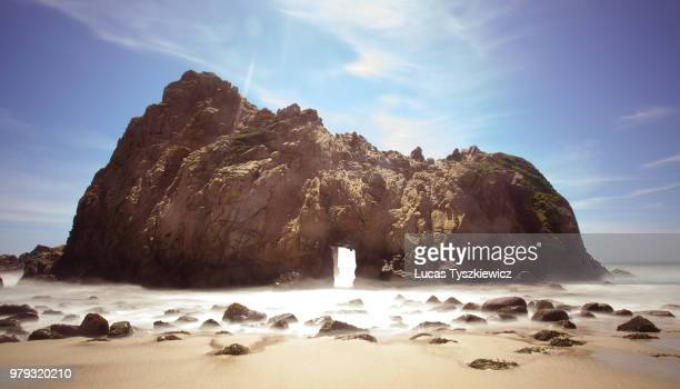 pfeiffer beach hollowed rock, california, usa - big sur stock pictures, royalty-free photos & images