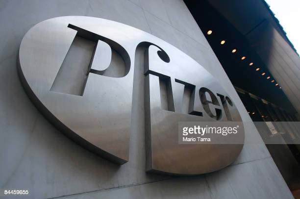 Pfizer sign hangs on the outside of their headquarters after a news conference discussing the planned merger of Pfizer and Wyeth January 26, 2009 in...