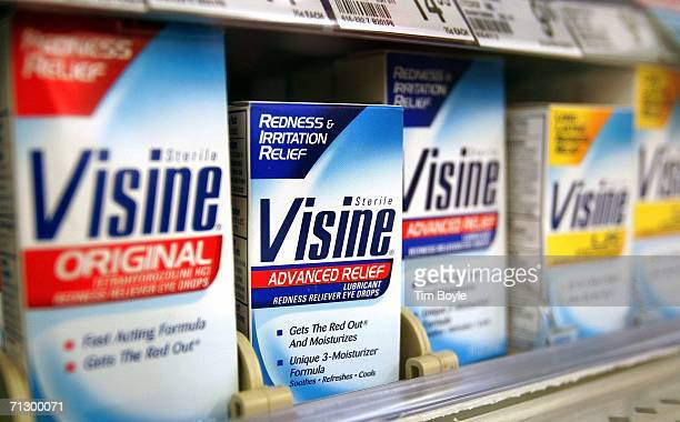 Pfizer's Visine is displayed in a glass case at a Walgreens store June 26 2006 in Chicago Illinois Johnson Johnson is buying Pfizer Inc's consumer...