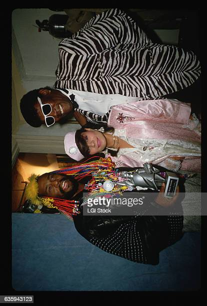 PFunk leader George Clinton holds a trophy and stands with singer Lisa Lisa and saxophonist Clarence Clemmons