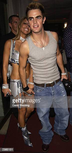 Pge 3 Model Jodie Marsh attends Pge 3 Model Lyndsay Dawn McKenzie's 25th Birthday party with her boyfriend at The Mayfair Club August 9 2003 in...