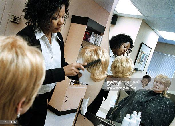 PG/hair Jahi Chikwendiu/TWP Debra Sanders owner/stylist of Classic Styles Salon styles a custom fitted and designed wig for Donna Sexton a...