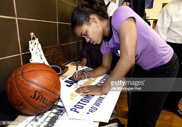 pgpotomac 3/19/04 Oxon Hill Md Mark Gail_TWP Potomac high school basketball player Lauren Brittingham signs a poster to be hung in the school before...