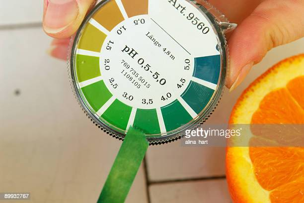 ph value determination orange fruit - ph value stock pictures, royalty-free photos & images
