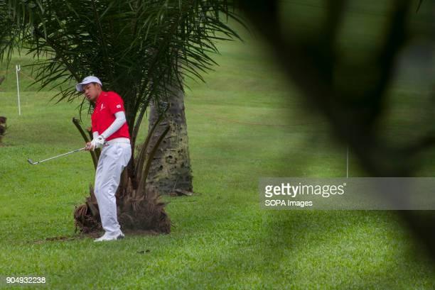 Phachara Khongwatmai is having a hard challenge through the trees on the last day at EurAsia Cup 2018 EurAsia Cup is a biennial men professional team...