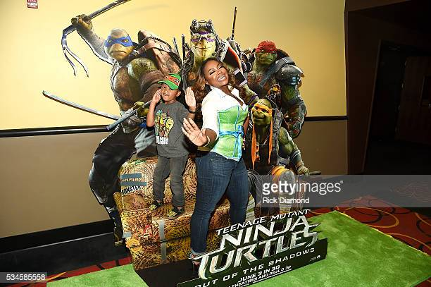 Phaedra Parks and Ayden Nida attend the Atlanta Screening of the Paramount Pictures title 'Teenage Mutant Ninja Turtles Out of the Shadows' on May 26...