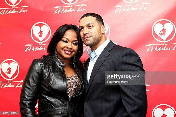 Phaedra Parks and husband Apollo Nida from Bravo's Real Housewives Of Atlanta poses for red carpet photos for A Mother's Love stage play at the...