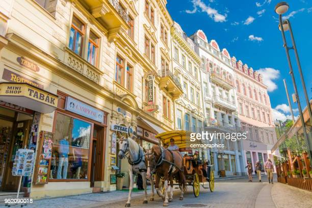 a phaeton is moving in the streets of karlovy vary. - karlovy vary stock pictures, royalty-free photos & images