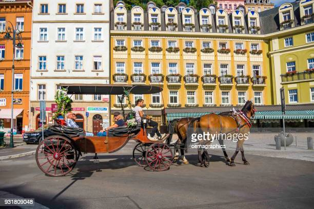 phaeton with peoples karlovy vary streets from czechia - karlovy vary stock pictures, royalty-free photos & images