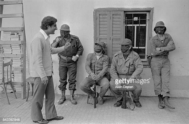 Phalangist militia leaderBashir Gemayel talks to some of his fighters.
