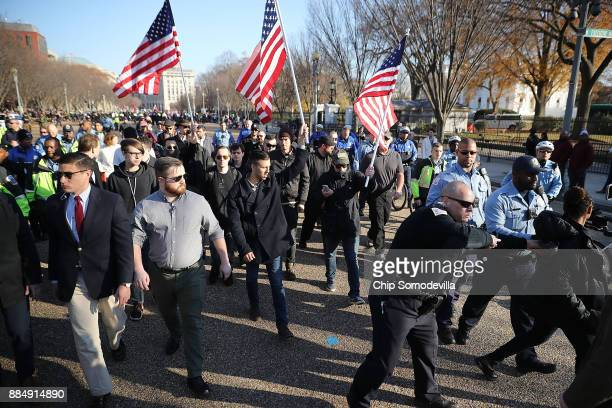Phalanx of Metropolitan Police Department officers shove pedestrians and journalists out of the way as they escort white nationalists and neo-Nazis...
