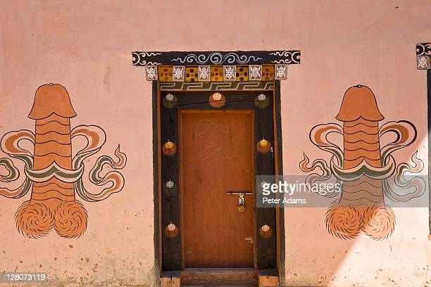 phallic fertility symbols painted outside house, pana, bhutan - penis stock pictures, royalty-free photos & images